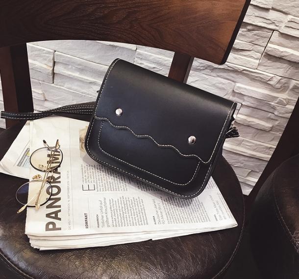 กระเป๋าถือ poppy bag (สี Black)